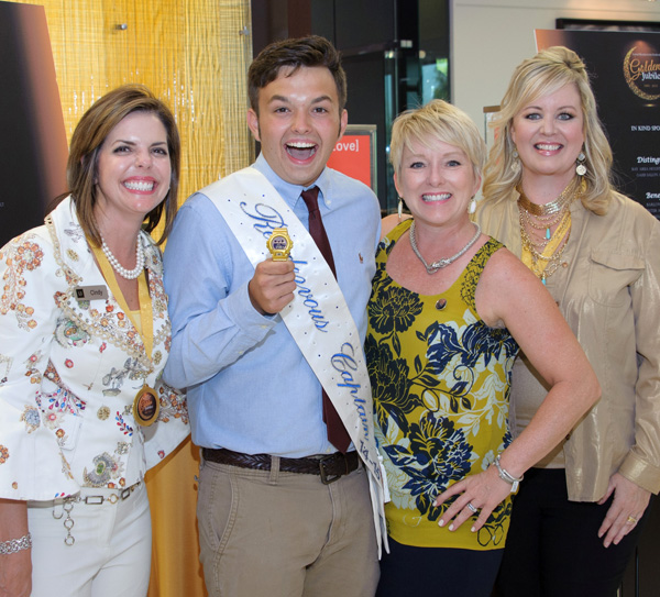 Lewis Jeweler's Cindy Lewis, from left, enjoys the Lunar Rendezvous Sponsor Party at her business in Webster with Festival Captain Jack Mullen, Judge Holly Williamson and Festival Chairman Jana Miller. Photo by J. Pamela Photography
