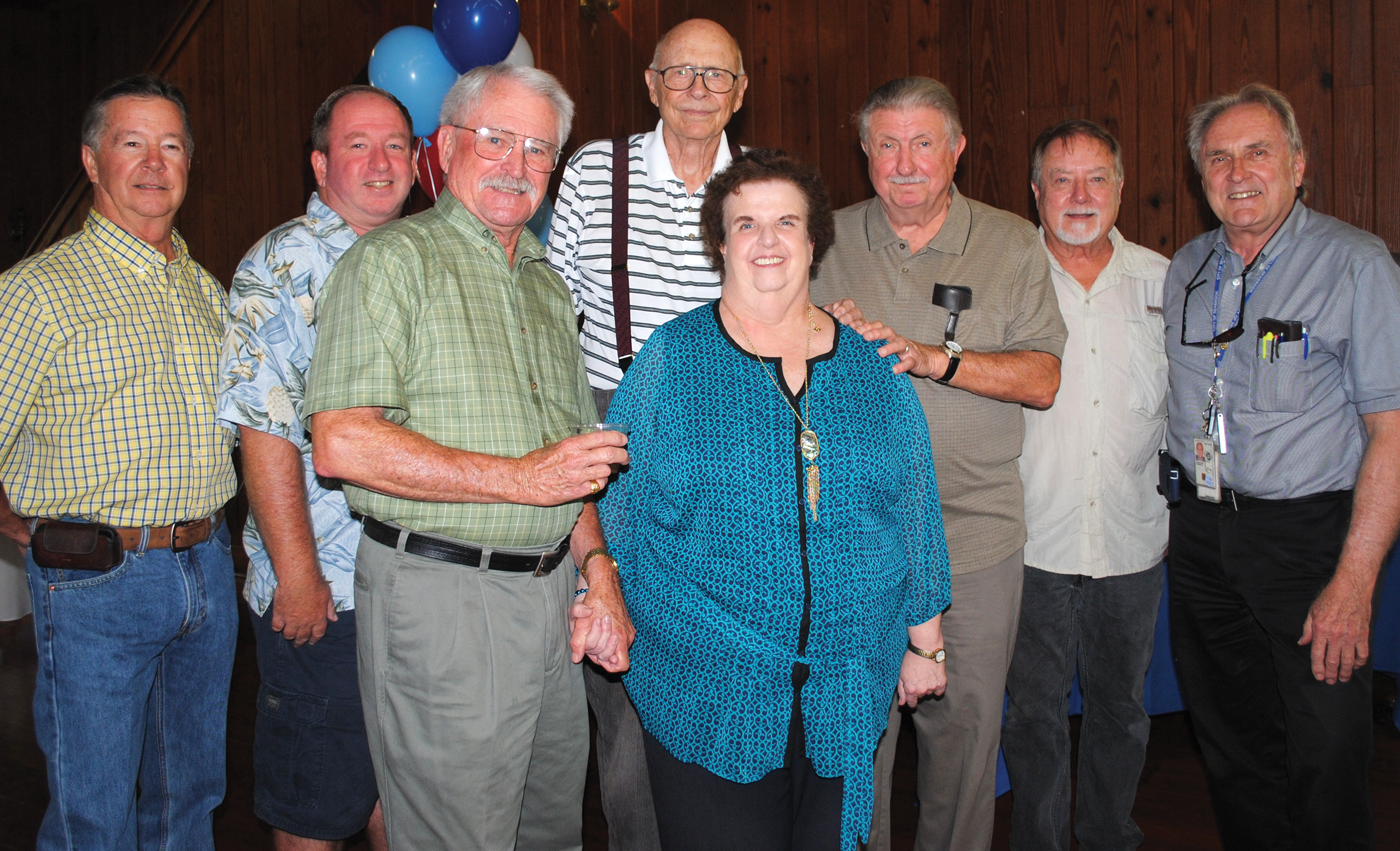 Many council members who have worked with City Secretary Michele Glaser over the past 36 years stopped by her retirement party to wish her well. Among those pictured with her are, from left, Skip Boteler, Don Holbrook, Herman Burton, Jerry Larson, Pete Braccio, Buddy Hammond and Tom Diegelman.