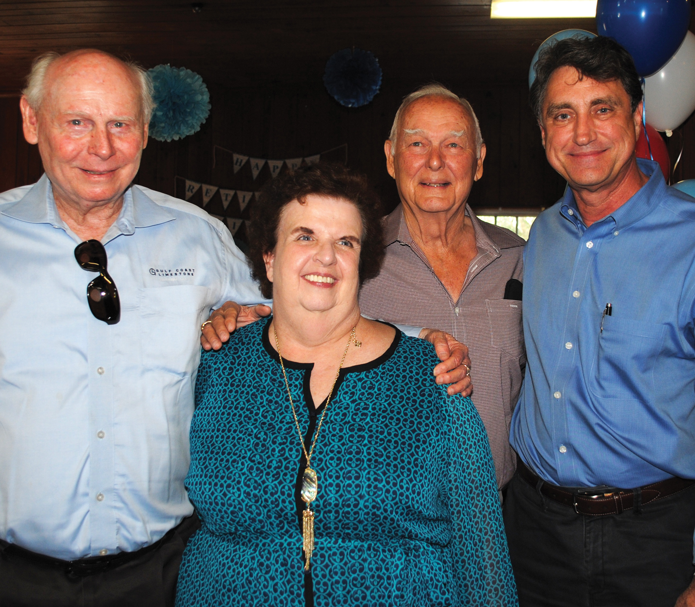 Seabrook Mayor Glenn Royal, right, former Mayor Bob Robinson, left, and Perry Christy wish Michele Glaser a happy bon voyage into retirement at the party in her honor. Christy's ancestors had the original Ritson- Morris Spanish land grant when they settled in what is now Seabrook many decades ago.