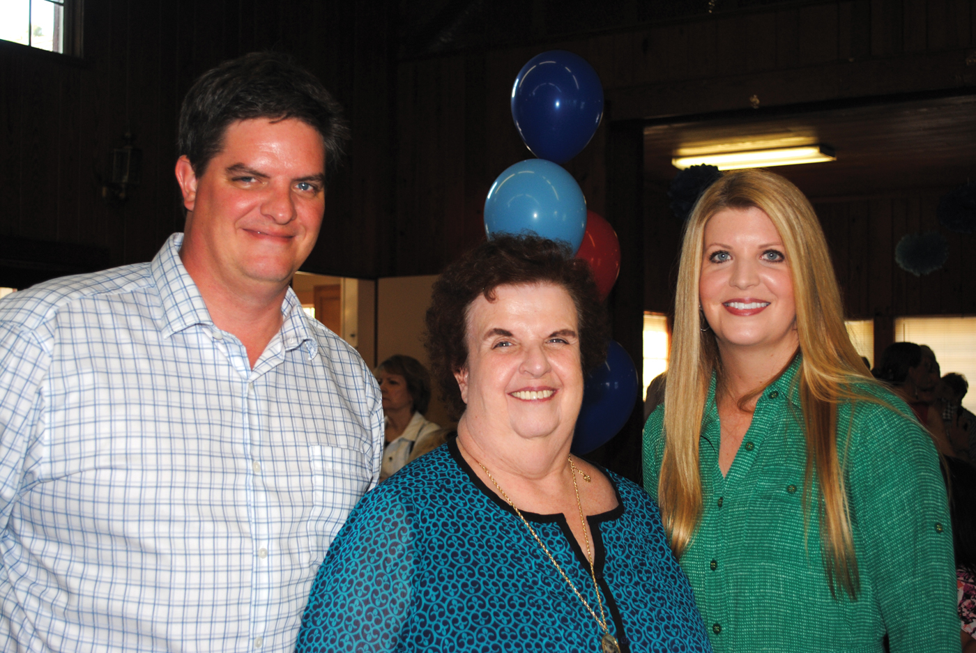 Spn Eric and daughter Ingrid join their mother, Seabrook City Secretary Michele Glaser, at her retirement party in the Seabrook Community House.