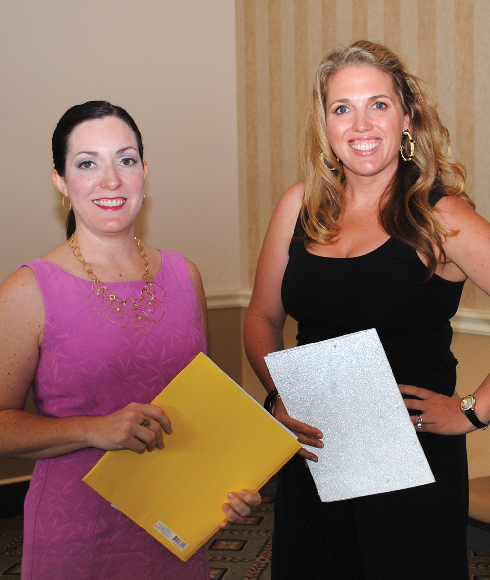 Bay Oaks Women's Association Vice Presidents Becky Hensley, left, and Cambrey Rogers go over plans for their Fall Fashion Show Tuesday, Sept. 9.