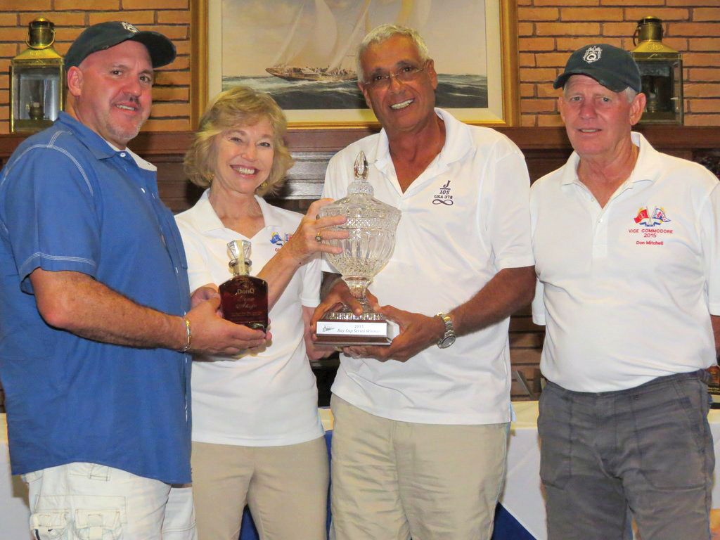 "Lakewood Yacht Club veteran racer Uzi Ozeri holds the Bay Cup II Series crystal trophy he won for the J/105 Fleet on his ""Infinity."" The series winners are those who have the best score in their fleet -- combining Bay Cup I held in March and Bay Cup II held Aug. 1 on Galveston Bay.  Pictured with him are regatta sponsor Steve Jurbala with DonQ Rum, LYC Commodore Joyce Maxell and Vice Commodore Don Mitchell."