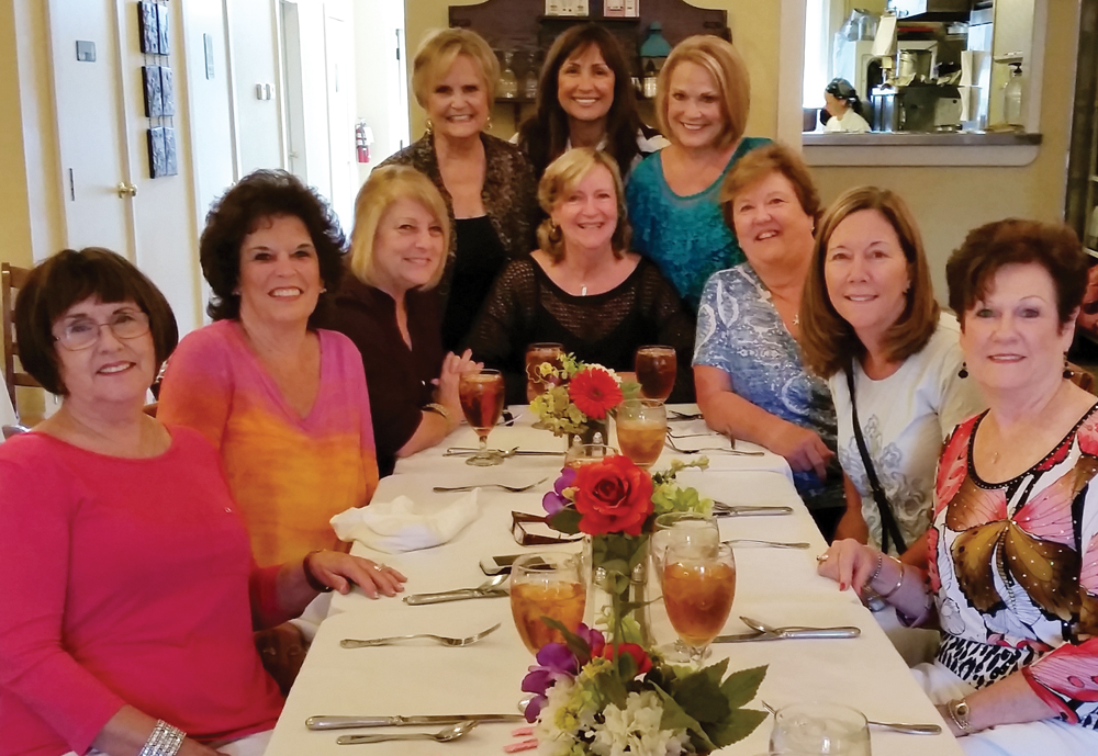 The Sassy Sistas enjoy dinner at the Jones House. They are, from left, standing, Jan Larson, Angie Weinman, Becky Reitz; seated, Sandi Allbritton, Emmeline Dodd, Diane Vest, Pam Culpepper, Carol Bergman, Karen Keesler and Anita Fogtman. Linda Flores Olson is missing from the photo.