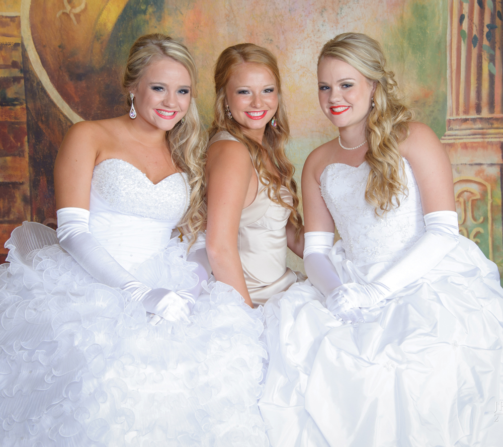 The Reason sisters make a pretty picture as they enjoy the Lunar Rendezvous Coronation Ball. They are, from left, Sydney Reason, Ashton Reason and Savannah Reason, daughters of Dan and Jill Reason of League City. Ashton was the 2014 queen alternate and her twin sisters were princesses this year.