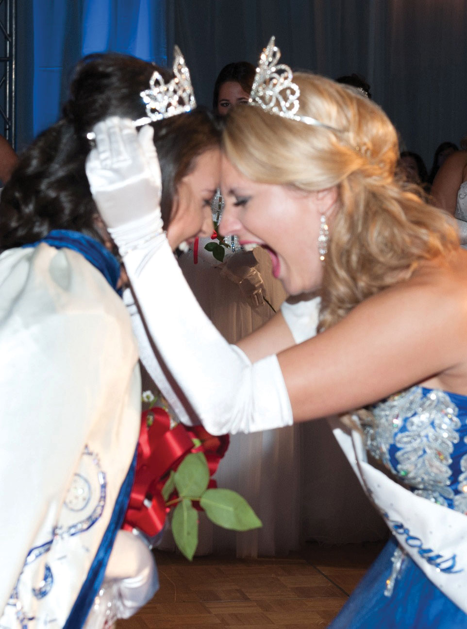 Look for plenty of excitement at the Lunar Rendezvous Coronation Ball when a new queen is crowned. Here, 2014 Queen Sydney Schroder, right, shares the exciting moment with  2015 Queen Allison Maureen Powell