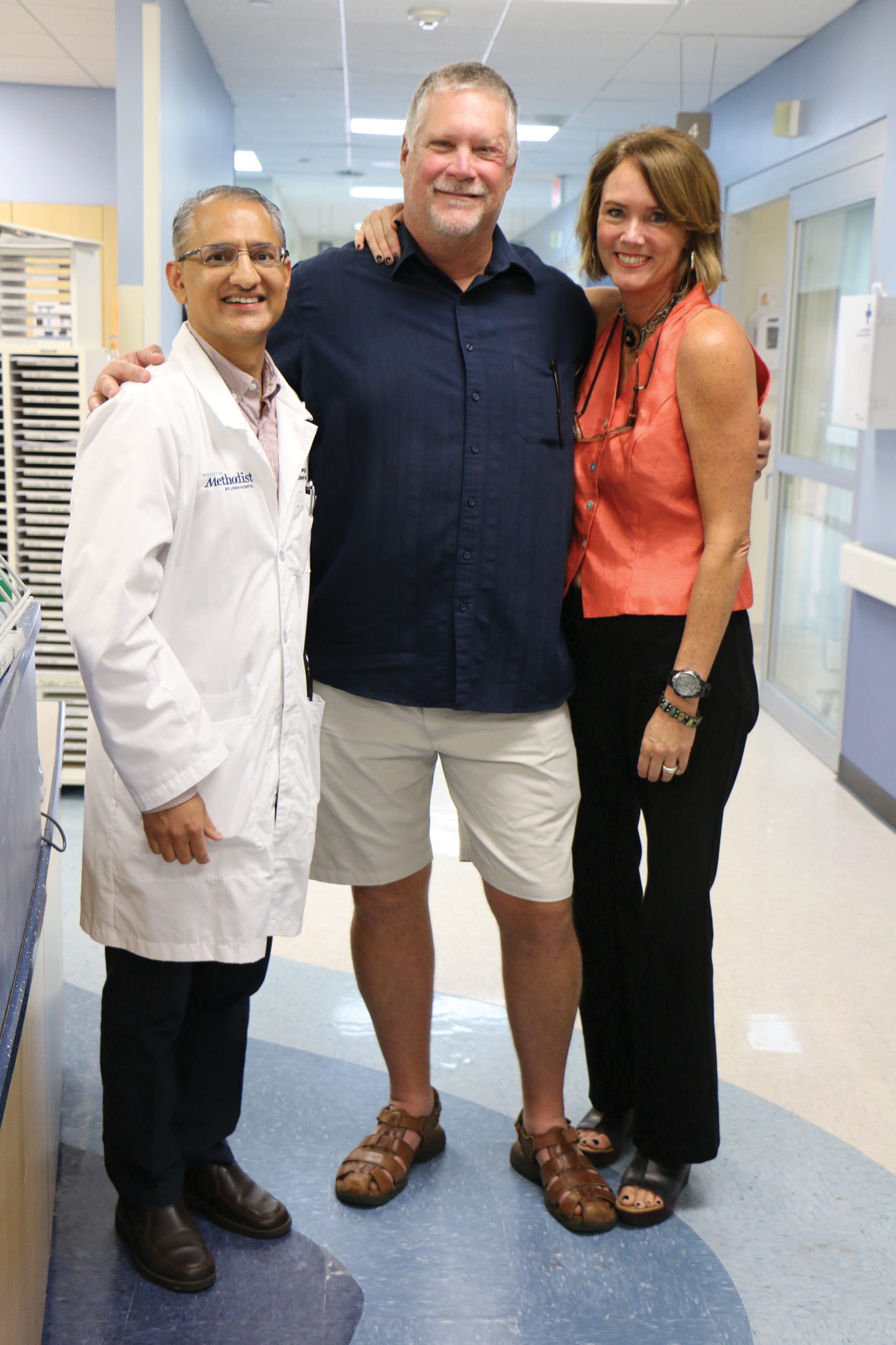 Curtis and Lisa Dishman visit with Houston Methodist St. John Hospital emergency medical physician, Dr. Sandeep Duggal.