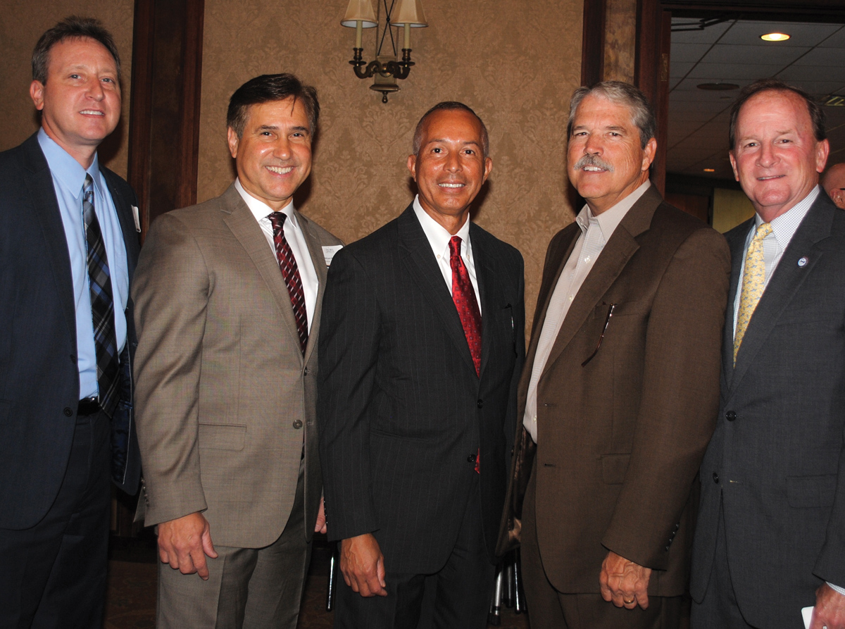 Houston Airport System Deputy Assistant Director Tim Joniec, Ellington Airport Director Arturo Machuca and Houston Airport System Director Mario Diaz, from left, join State Sen. Larry Taylor and Houston City Councilman Dave Martin at the Bay Area Houston Economic Partnership luncheon at Lakewood Yacht Club in Seabrook.