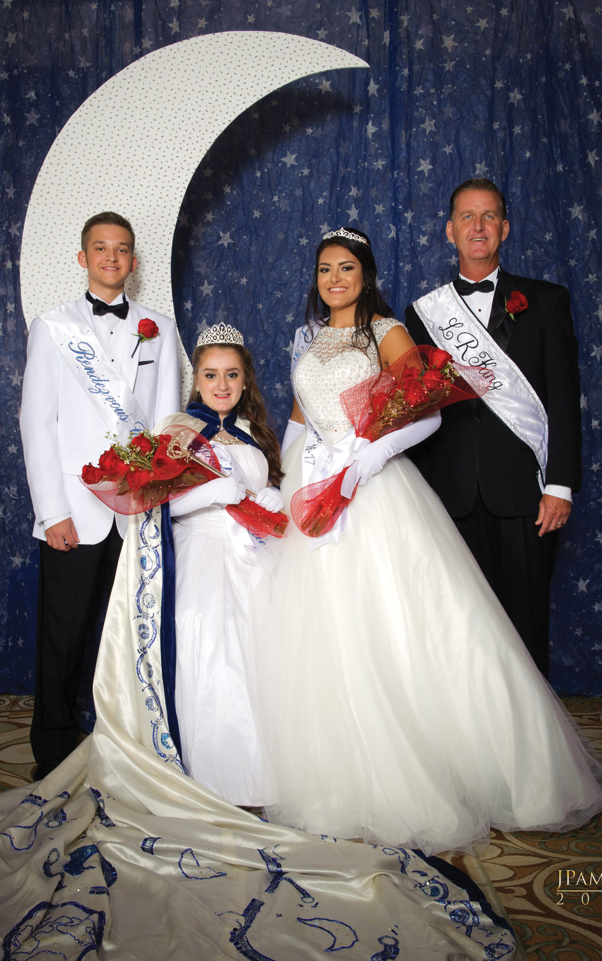2017 Lunar Rendezvous Queen Madelyn Claire Emilia Chidester poses for a photo with King Kevin Duke, right, Queen Alternate Alexa Rae Trevino and Captain Alexander Edward Struss at the Coronation Ball in Galveston. They will reign over next year's festival. Photo by J. Pamela Photography