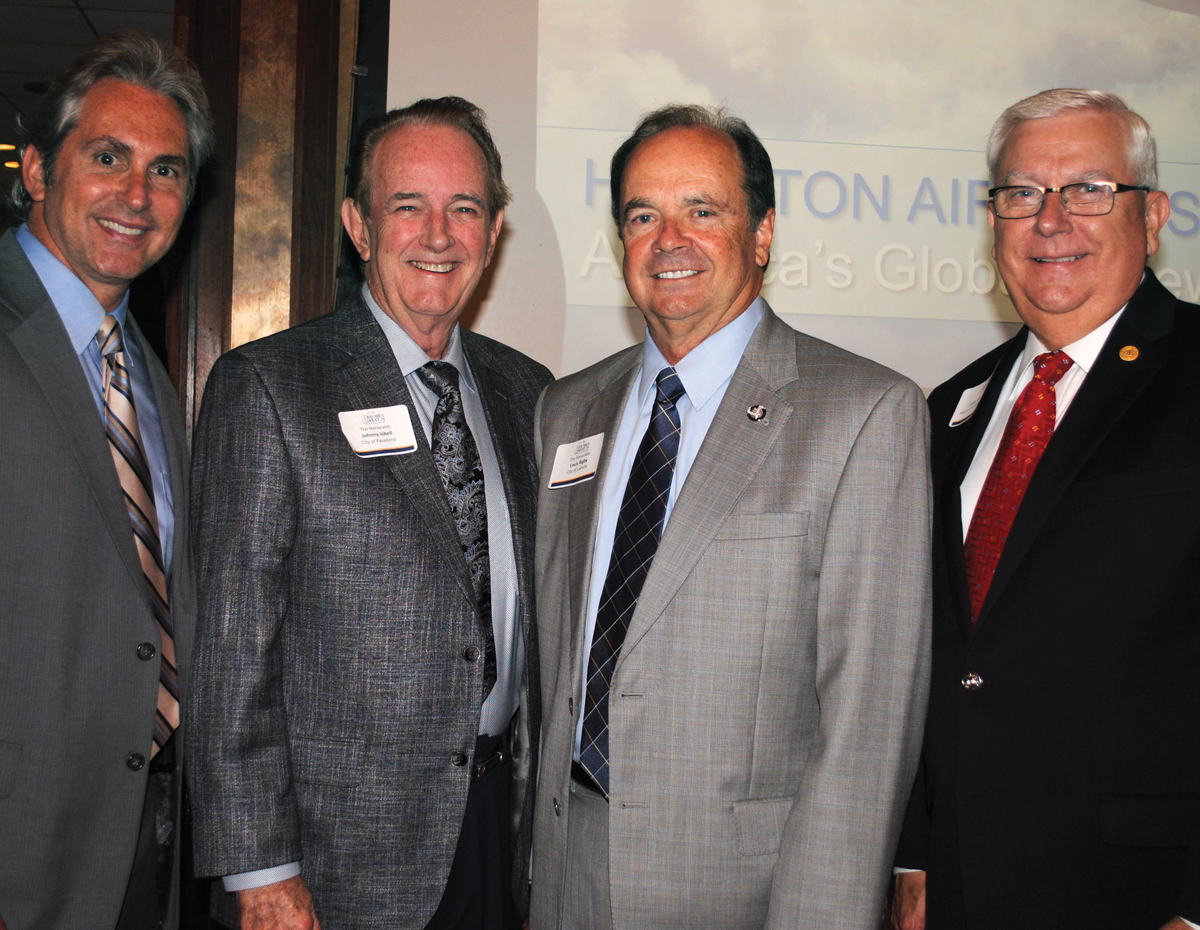 Pasadena City Councilman Jeff Wagner and Mayor Johnny Isbell, from left, arrive at the Bay Area Houston Economic Partnership luncheon at Lakewood Yacht Club in Seabrook, along with La Porte Mayor Louis Rigby and Port Commissioner John Kennedy of Nassau Bay to hear Houston Airport System Director Mario Diaz.