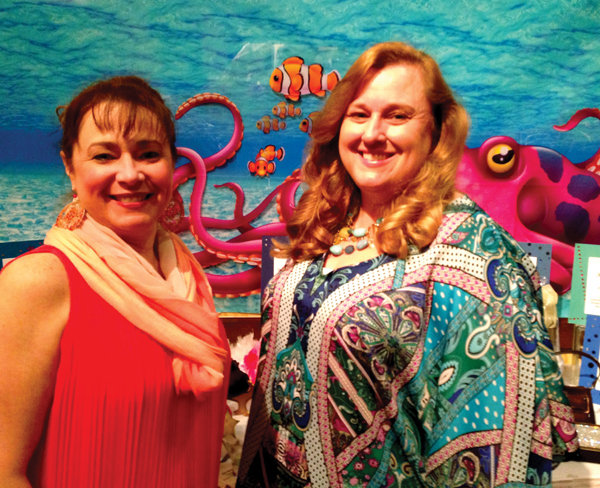 Assistance League President Lisa Holbrook, left, and President-elect Kim Barker check out the decorations as they prepare to greet the arriving crowd for the Under the Sea Gala at the Hobby Marriott.