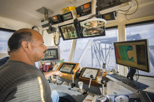 An Orion captain, contracted by the Port Authority, oversees the dredging at Barbours Cut.