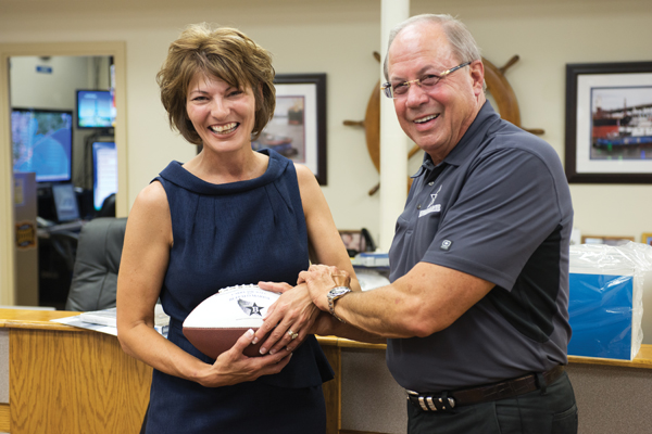 "Buffalo Marine's CEO, Pat Studdert presents the Buffalo ""don't drop the ball"" to its newest honorary team member, Dr. Hellyer."