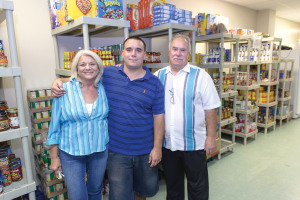 Cut line for Photo:  The Redford Family, from left, Gail, Kyle and Rodney in the North Channel Assistance Ministries Food Pantry.