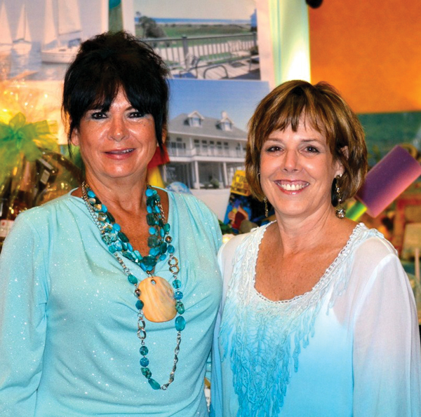 "Gala Chairman Kathleen Courville, left, and Vice Chairman Dee Cover take a last quick look at the Hobby Marriott Ballroom as they crowd begins arriving for an evening ""Under the Sea."""