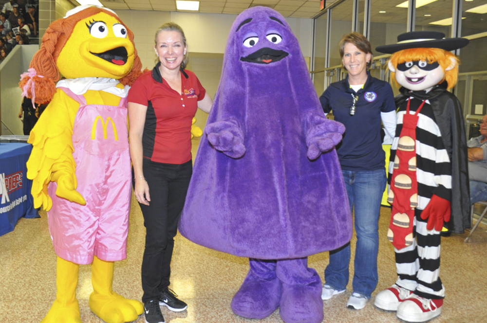 Liz Tolleson and Jana Williams of the PISD Athletics Dept. with some of McDoanld's well known characters.