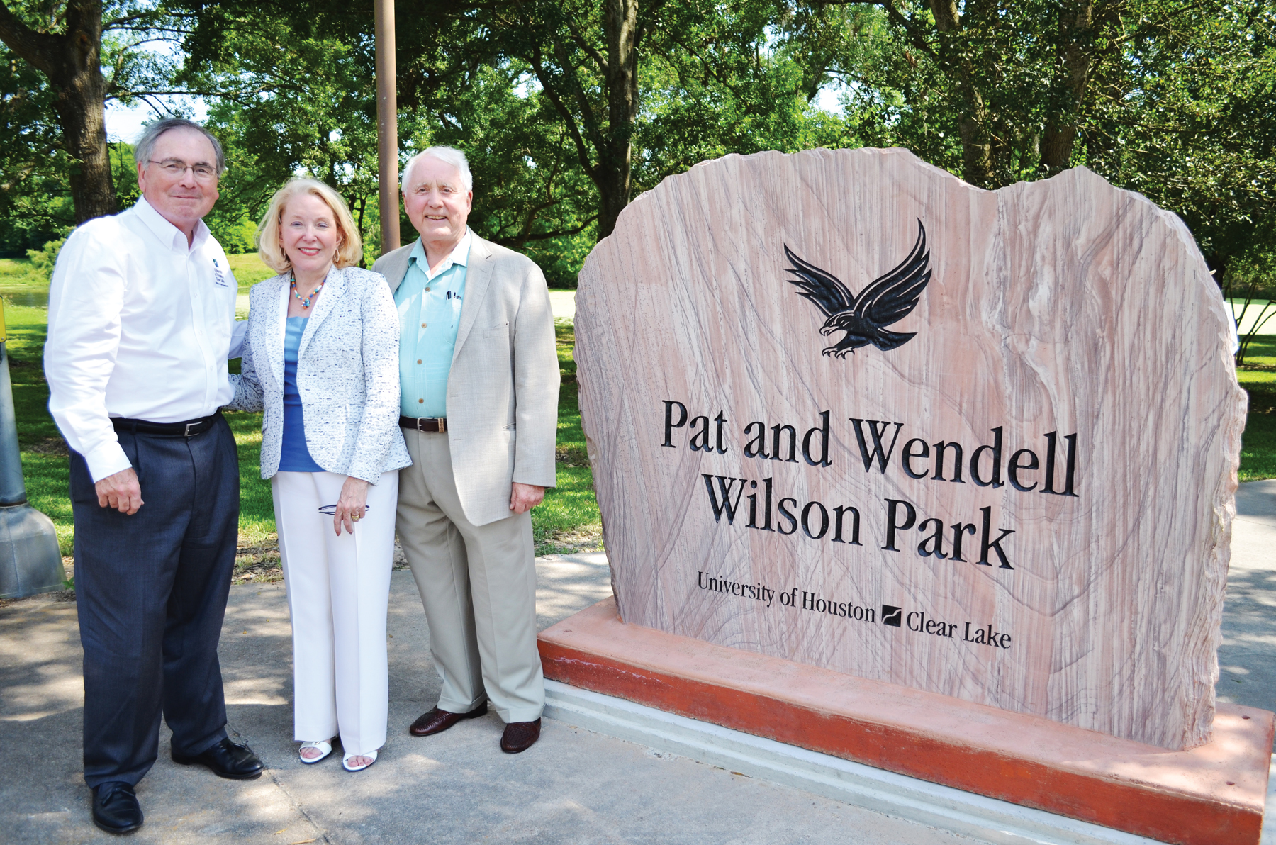 UH-Clear Lake President Dr. Bill Staples, left, thanks Pat and Wendell Wilson for all they have done for the university at the dedication of the park being built to honor them.