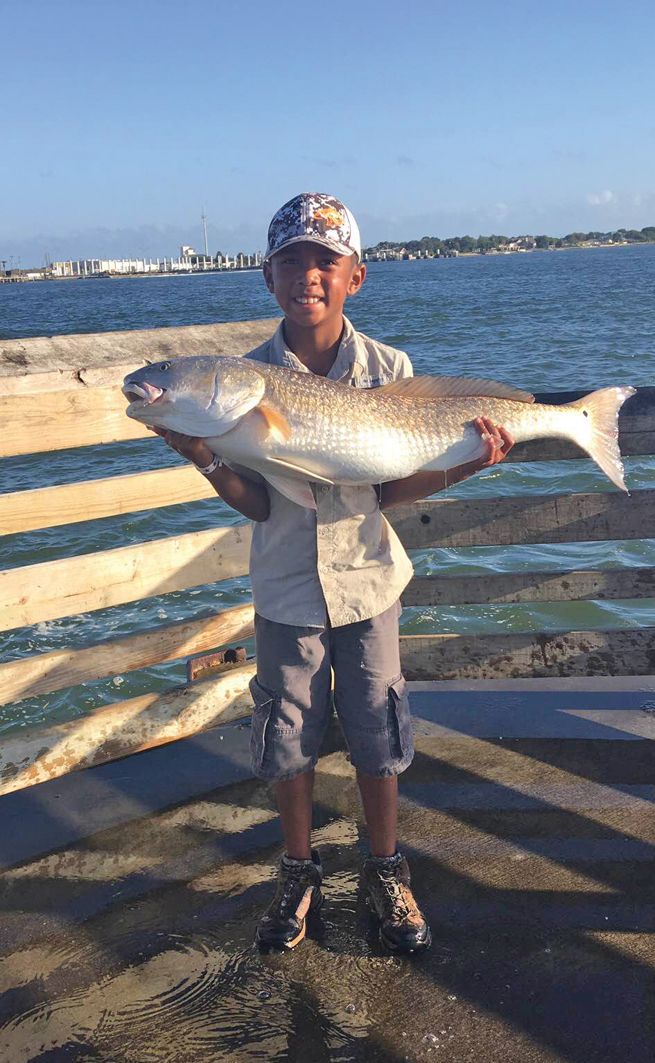 Eight-year-old Aden Viet Johnson with an impressive redfish.