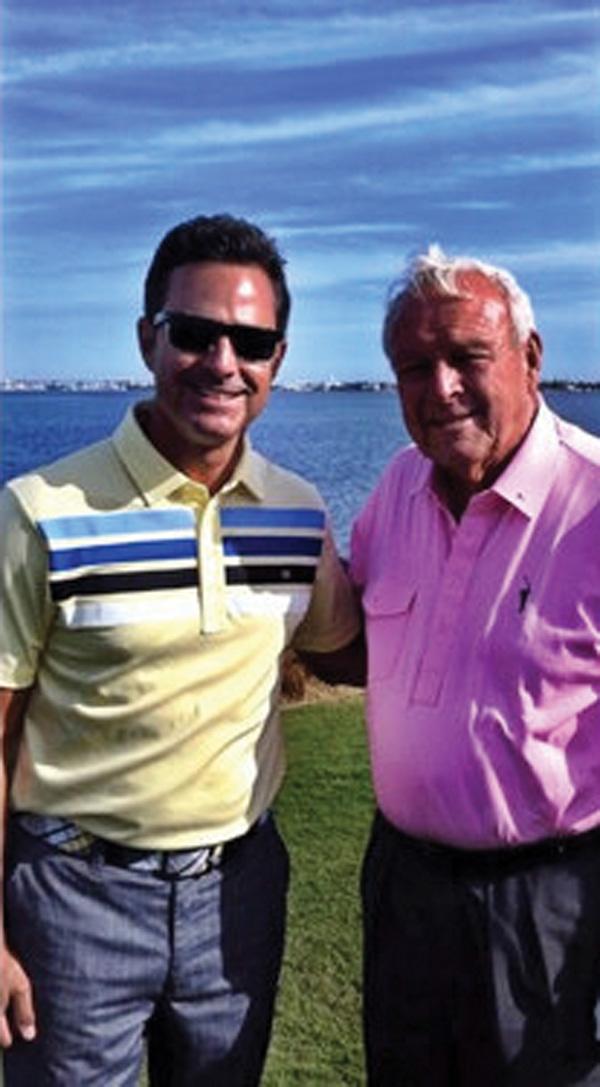 Claude Harmon III with Arnold Palmer.