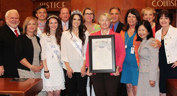 Houston Mayor Annise Parker holds up the proclamation as she stops for a photo with, from left, Councilman Michael Kubosh, Terri Dieste, Festival Capt. Jack Mullen and Queen Alternate Demerle Monks, District E Councilman Dave Martin, Festival Queen Allison Powell, Jill Williams, Michael Landolt, Kippy Caraway, Gloria Wong, Mary Ann Shallberg and Annette Dwyer.
