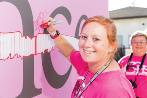 "Dana Tegeler, athletic trainer at Clear Creek High School, was among the first to sign the ""Strike Through Cancer Wall"" during Clear Creek High School's football game against Brazoswood on Oct. 9."