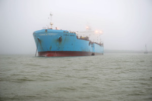 The chemical tanker Carla Maersk sits at anchor off Morgan's Point, Texas, after being involved in a collision with the bulk carrier Conti Peridot March 9, 2015. The Maersk was carrying about 216,000 barrels of Methyl Tertiary Butyl Ether and an unknown quantity of the product was spilled. (U.S. Coast Guard photo by Petty Officer 3rd Class Dustin R. Williams)