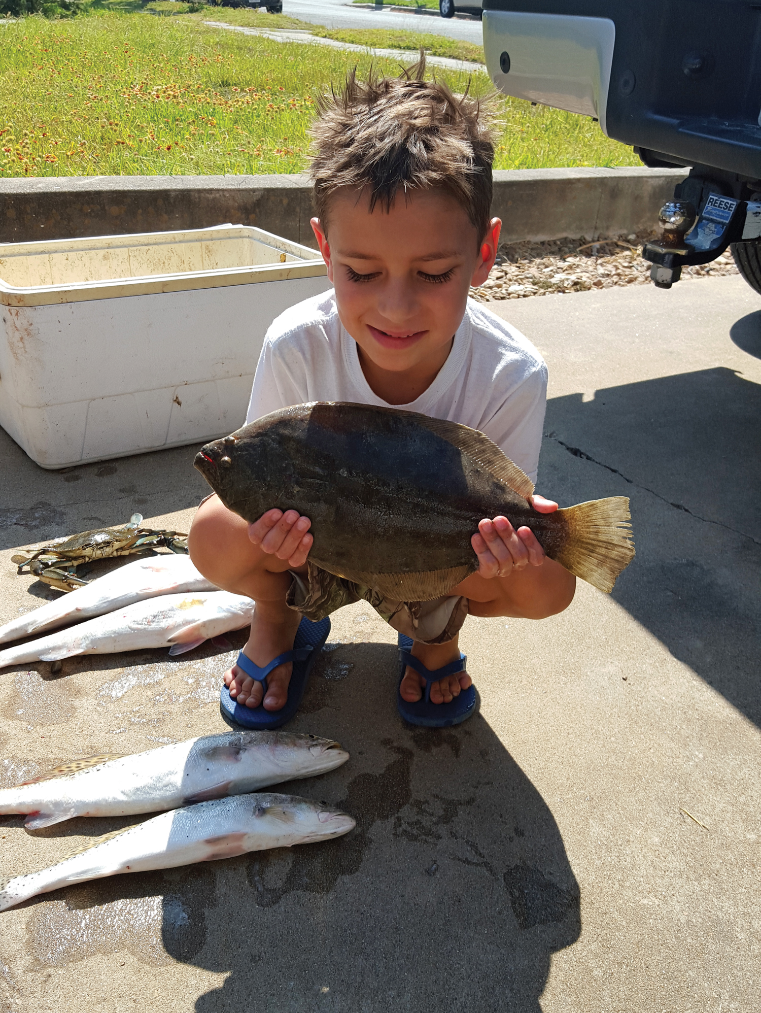 Timothy Koenning with his first flounder! He caught the 17-inch flattie on live shrimp while fishing with his dad and stepmom in West Bay. Four trout, from 16-21 inches were caught as well.